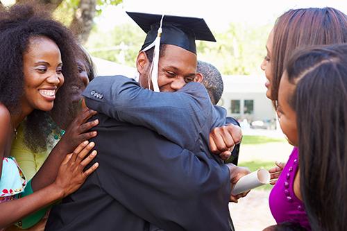 Family hug from son graduation